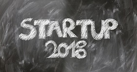 A Board with Startup 2018 written on it